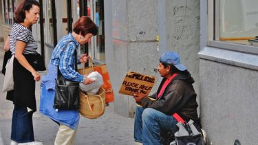 People helping homeless man.